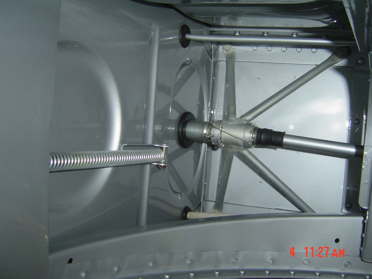 View from the wheel well; conduit & mounting bracket